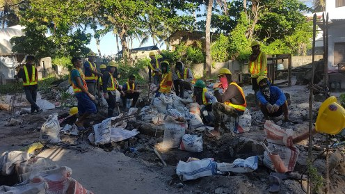 Workers take breather after a clearing operation along Bolabog Road in Boracay Island, Philippines.
