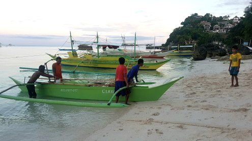 Fishermen dock their tourist boat along the shoreline at Hidden Beach as the government announce closure of Boracay Island.